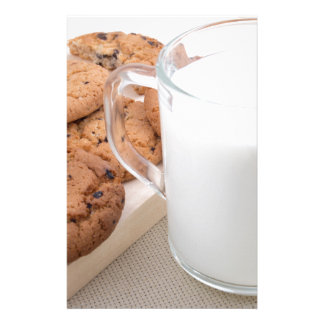 Cup with milk and oatmeal cookies stationery