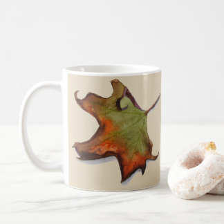 Cup with watercolor of autumnal leaf with bottom