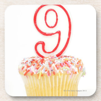 Cupcake with a numbered birthday candle 3 drink coasters