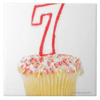Cupcake with a numbered birthday candle 7 ceramic tile