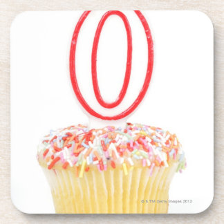 Cupcake with a numbered birthday candle beverage coasters