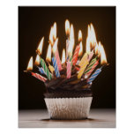 Cupcake with birthday candles posters