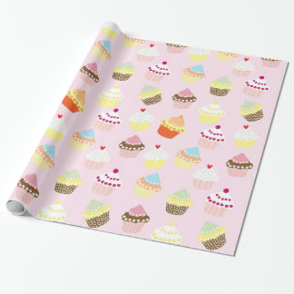 Cupcakes on pink wrapping paper