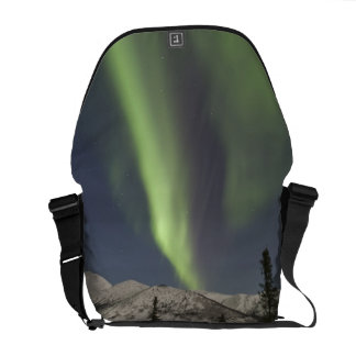 Curtains of aurora borealis dance across the sky commuter bag