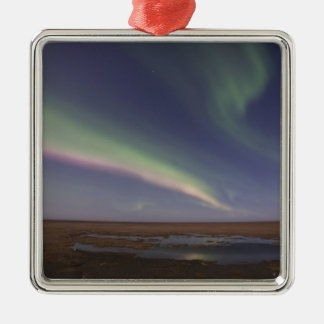 Curtains of colored northern lights metal ornament