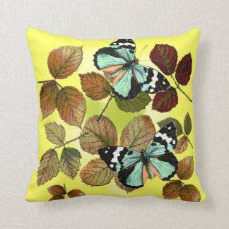 Cushion of autumn, dry leaves and blue butterflies