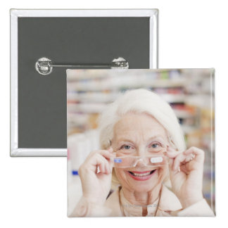 Customer trying in prescription eyeglasses in 15 cm square badge