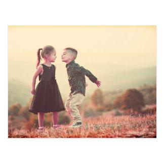 customizable vintage kissing kids under sun postcard