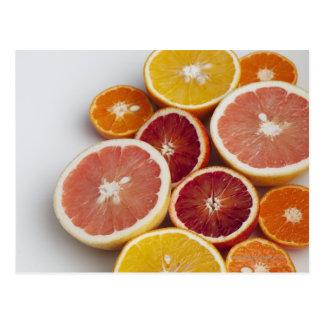 Cut Oranges on table Postcard