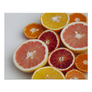 Cut Oranges on table Poster