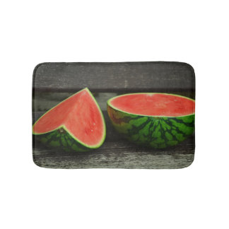 Cut Watermelon on Rustic Wood Background Bath Mats