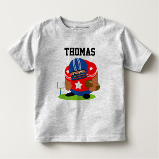 Cute American football player holding a football, Toddler T-Shirt