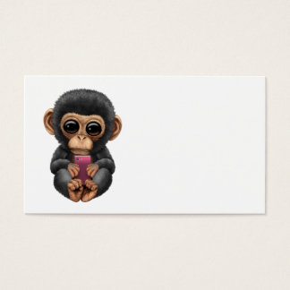 Cute Baby Chimpanzee Holding a Pink Cell Phone