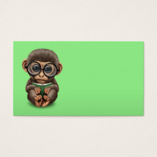 Cute Baby Monkey Reading a Book on Green