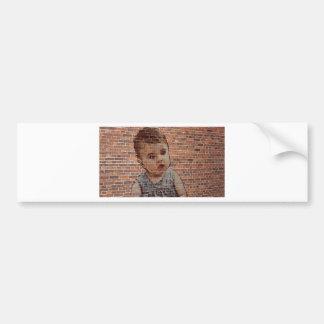 Cute baby on brick wall. bumper sticker