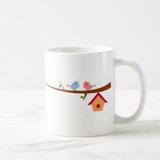 Cute birds on branches coffee mug