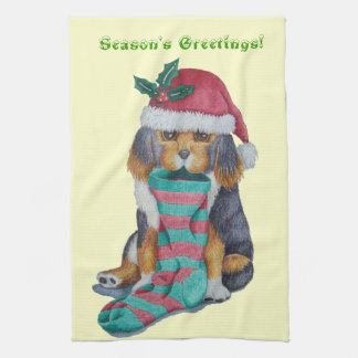 cute black and brown puppy with christmas stocking tea towel