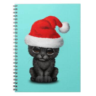 Cute Black Panther Cub Wearing a Santa Hat Notebooks