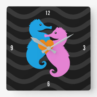Cute Blue and Pink Seahorses in Love on Grey Waves Clocks