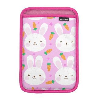 Cute cartoon bunnies and carrots on pink pattern iPad mini sleeve