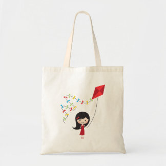 Cute cartoon girl with kite tote bag
