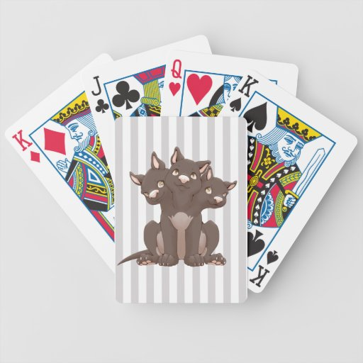 Cute cerberus puppy playing cards