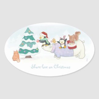 Cute Christmas animals decorating a snowy tree Oval Sticker