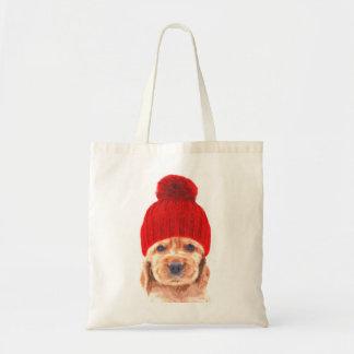 Cute cocker spaniel puppy with cap portrait tote bag