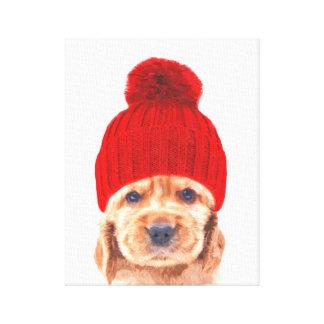 Cute cocker spaniel puppy with hat portrait canvas print