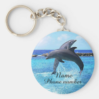 Cute dolphins in the sea key ring