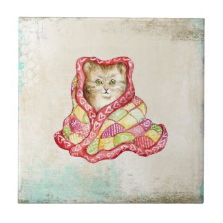 Cute domestic kitten with a red adorable blanket small square tile