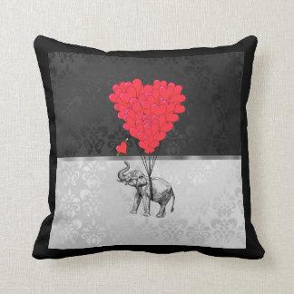 Cute elephant and love heart on gray cushion
