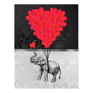 Cute elephant and love heart on grey postcard