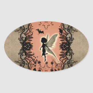 Cute fairy silhouette with glowing shine, oval sticker