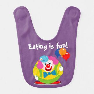 Cute fun cartoon circus clown with a big red nose, baby bib