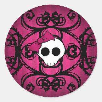 Cute gothic skull on fuschia and black round sticker