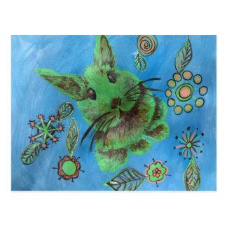 Cute green bunny on blue postcard