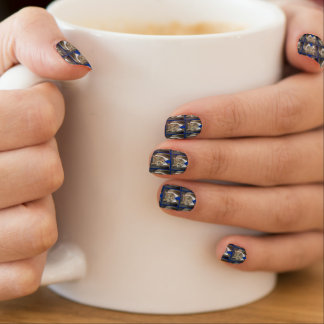 Cute green-eyed brown tabby cat wearing a blue tie minx nail art