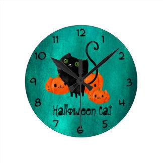 Cute Halloween cat with pumpkins Clock