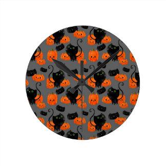 Cute Halloween cat with pumpkins Clocks