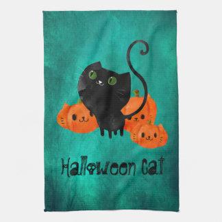Cute Halloween cat with pumpkins Hand Towel