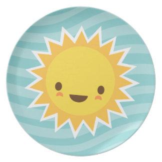 Cute kawaii sun cartoon character on blue dinner plate