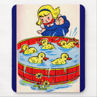cute little girl with a pool full of ducklings mouse pad