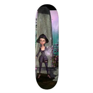 Cute little witch with skateboard decks