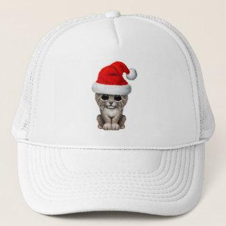 Cute Lynx Cub Wearing a Santa Hat