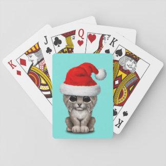 Cute Lynx Cub Wearing a Santa Hat Playing Cards