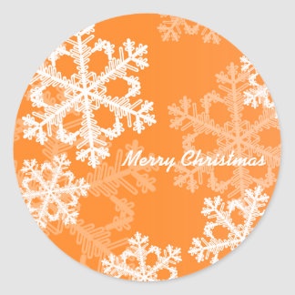 Cute orange and white Christmas snowflakes Round Sticker