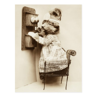 Cute puppy in a dress talking on the phone postcard