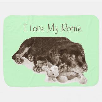 cute rottweiler puppy dog cuddling teddy bear art baby blanket