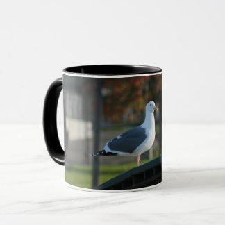 Cute seagull standing on bridge mug